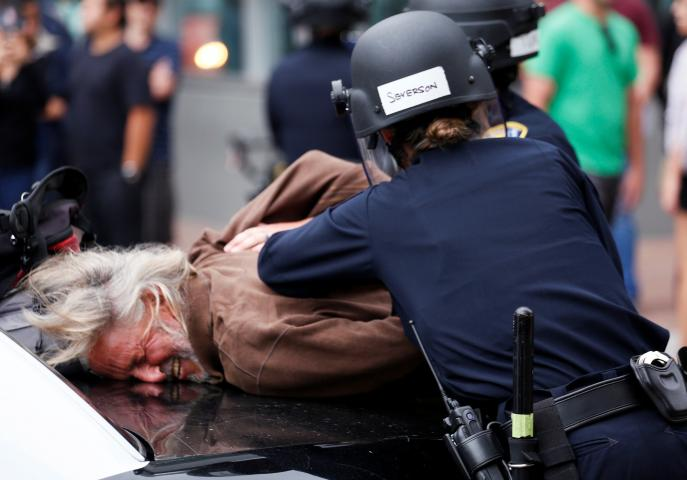 A man is arrested during a demonstration against Republican U.S. presidential candidate Donald Trump outside his campaign event in San Diego, California , U.S. May 27, 2016. REUTERS/Jonathan Alcorn