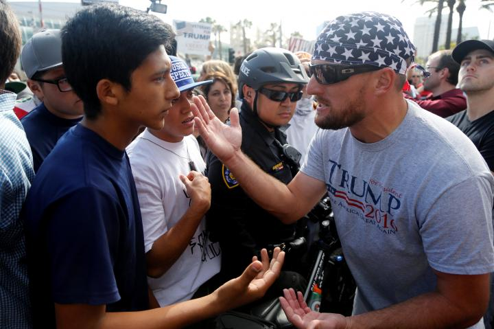 An anti-Trump demonstrator (L) and a Trump supporter (R) argue outside a campaign event for U.S. presidential candidate Donald Trump in San Diego, California, U.S. May 27, 2016. REUTERS/Jonathan Alcorn