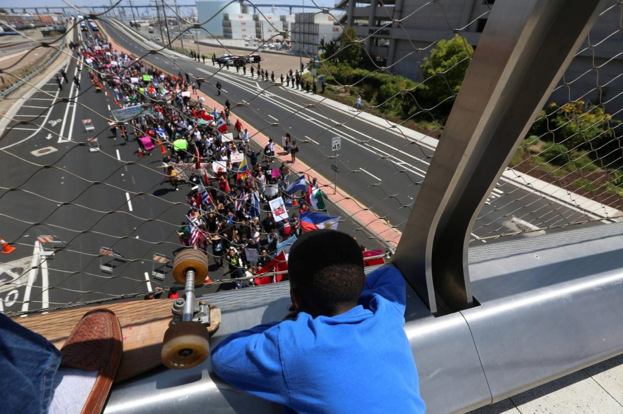 A child watches as marchers make their way to the San Diego Convention Center to protest against Republican U.S. presidential candidate Donald Trump in San Diego, California , U.S. May 27, 2016. REUTERS/David McNew