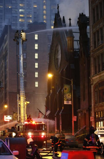 Firefighters battle a fire in the historic Serbian Orthodox Cathedral of St. Sava, Sunday, May 1, 2016, in New York. The church that was constructed in the early 1850s and was designated a New York City landmark in 1968. (AP Photo/Kathy Willens)
