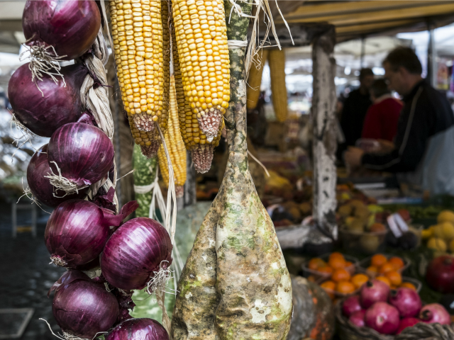 onions and corns are hanged on a stall at the Campo di Fiori food market, in central Rome, on November 4, 2014.