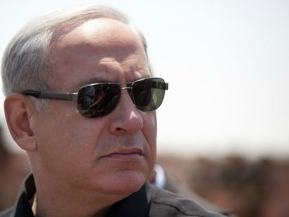 Israeli Prime Minister Benjamin Netanyahu visits an Israeli military base on the Israeli side of the border with Egypt after militants drove an Egyptian military vehicle through a security fence, on August 6, 2012 in Kerem Shalom, Israel.