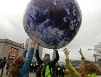 Environmental activists play with a giant globe on the streets in a rally demanding more action to battle climate change during the 19th conference of the United Nations Framework Convention on Climate Change (COP19) in Warsaw November 16, 2013. REUTERS/KACPER PEMPEL