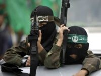 Palestinian young jihad boys take part in a rally of Hamas supporters to commemorate the 27th anniversary of the Islamist movements creation and to ask for the reconstruction of the Gaza Strip on December 12, 2014 in Jabalia refugee camp in the northern Gaza Strip.