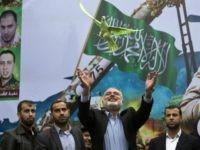 Gaza Hamas leader Ismail Haniya releases a dove during a rally of Hamas supporters to commemorate the 27th anniversary of the Islamist movements creation and to ask for the reconstruction of the Gaza Strip on December 12, 2014 in Jabalia refugee camp in the northern Gaza Strip.