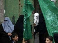 Palestinian women take part in a rally of Hamas supporters to commemorate the 27th anniversary of the Islamist movements creation and to ask for the reconstruction of the Gaza Strip on December 12, 2014 in Jabalia refugee camp in the northern Gaza Strip.