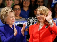 Democratic presidential candidate Hillary Clinton, left, applauds after former Arizona congresswoman Gabrielle Giffords, right, spoke at a Women for Hillary event at the New York Hilton hotel in midtown Manhattan one day ahead of the New York primary, Monday, April 18, 2016, in New York. (AP Photo/Kathy Willens)