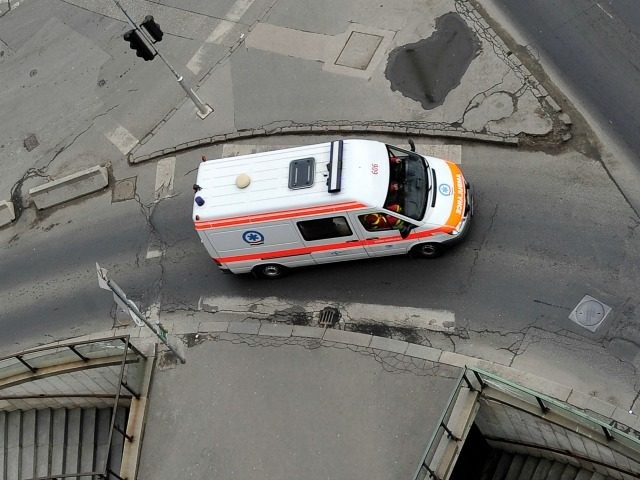 A rescue car driver maneuvers on a street of Budapest downtown on February 22, 2011.