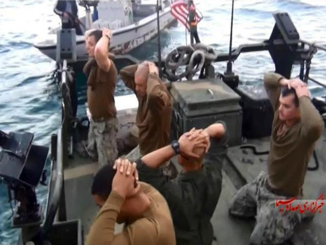This frame grab from Tuesday, January 12, 2016 video by the Iranian state-run IRIB News Agency, shows detention of American Navy sailors by the Iranian Revolutionary Guards in the Persian Gulf, Iran. The 10 U.S. Navy sailors detained by Iran after their two small boats allegedly drifted into Iranian territorial …