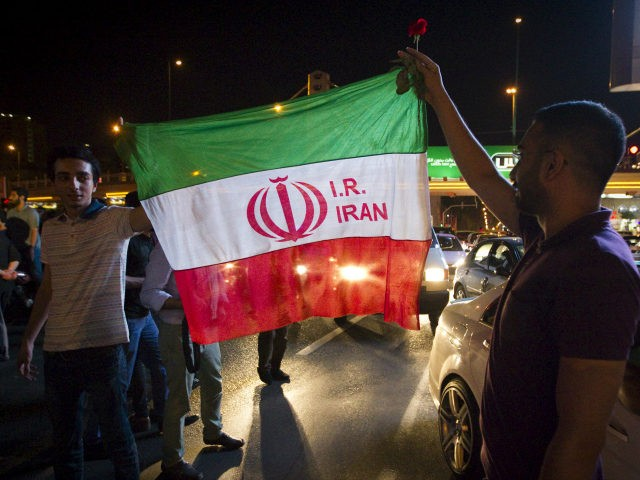 Iranians celebrate on the streets following a nuclear deal with major powers, in Tehran July 14, 2015. REUTERS/TIMA/FILES
