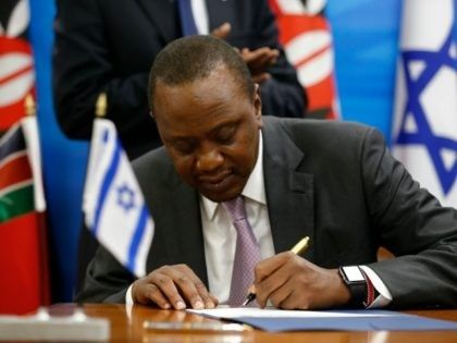 Kenya's President Uhuru Kenyatta sign agreements with Israeli Prime Minister in Jerusalem on February 23, 2016.