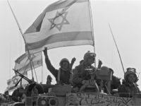 Israeli Defense Force (IDF) soldiers seated atop their tanks flash V-signs as they pull out of the Nabatiyah Triangle, a hostile Shi'ite hill country in the South Lebanon 11 April 1985 during the second phase of Israeli withdrawal from Lebanon.