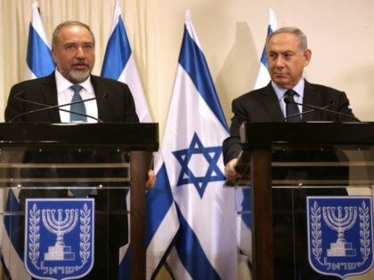 Israeli Prime Minister Benjamin Netanyahu (R) and Avigdor Lieberman (L), the head of hardline nationalist party Yisrael Beitenu, are seen during a ceremony in which they signed a coalition agreement on May 25, 2016 at the Knesset, the Israeli parliament in Jerusalem.