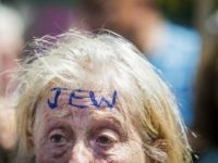 A woman with the word 'JEW' inked on her forehead attends an anti-fascist demonstration on Whitehall in central London on July 4, 2015, countering an anti-Jewish rally held by a group of far-right protesters.