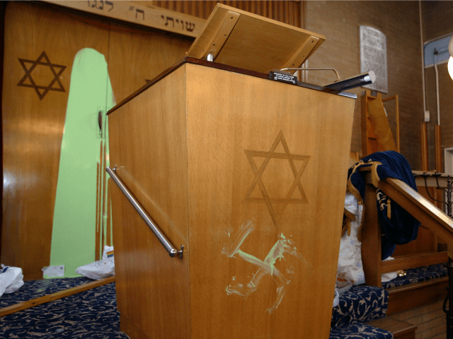 A swastika is daubed beneath the Star of David on a preaching lectern April 30, 2002 at Finsbury Park Synagogue in London.