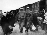 circa 1941: Nazi officers supervise Jews leaving railway trucks during the deportation to the camps. (Photo by Hulton Archive/Getty Images)