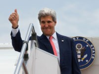 U.S. Secretary of State John Kerry makes the thumbs up sign as he leaves Malaysia from Subang TUDM outside of Kuala Lumpur, Malaysia, on Friday, Oct. 11, 2013, completing his trip to Malaysia after U.S. President Barack Obama cancelled his trip to the region due to the U.S. government shutdown. (AP Photo/Jacquelyn Martin, Pool)