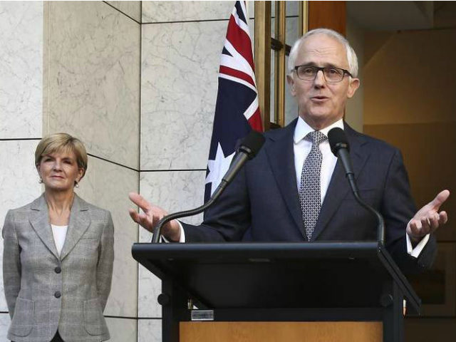 Australia Prime Minister Malcolm Turnbull announces his new cabinet as Foreign Minister Julie Bishop, left, looks on during a press conference at Parliament House in Canberra, Australia, Sunday, Sept. 20, 2015. Turnbull announced sweeping changes to his first Cabinet and promoted more women from two to five, including Australia's first female Defense Minister Marise Payne. (AP Photo/Rob Griffith)