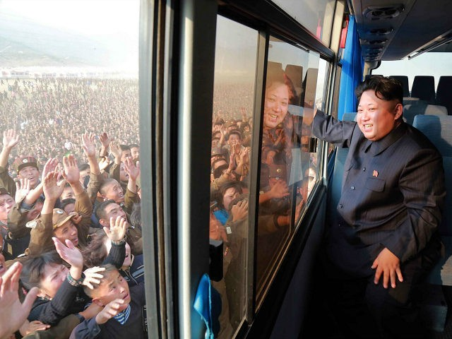 "DEMOCRATIC PEOPLE'S REPUBLIC OF KOREA, Rason : This picture released from North Korea's official Korean Central News Agency (KCNA) on October 8, 2015 shows North Korean leader Kim Jong-Un (R) waving to a crowd from a bus while inspecting a newly-built village at Paekhak-dong in Sonbong District of flood-hit Rason City. AFP PHOTO / KCNA via KNS REPUBLIC OF KOREA OUT THIS PICTURE WAS MADE AVAILABLE BY A THIRD PARTY. AFP CAN NOT INDEPENDENTLY VERIFY THE AUTHENTICITY, LOCATION, DATE AND CONTENT OF THIS IMAGE. THIS PHOTO IS DISTRIBUTED EXACTLY AS RECEIVED BY AFP. ---EDITORS NOTE--- RESTRICTED TO EDITORIAL USE - MANDATORY CREDIT ""AFP PHOTO / KCNA VIA KNS"" - NO MARKETING NO ADVERTISING CAMPAIGNS - DISTRIBUTED AS A SERVICE TO CLIENTS"