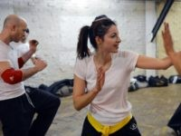 People take part in a Krav Maga training session, on March 14, 2013 in Paris.