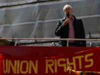Britain's opposition Labour Party leader Jeremy Corbyn gives a speech from the top of a double-decker bus at a May Day rally in London on May 1, 2016.