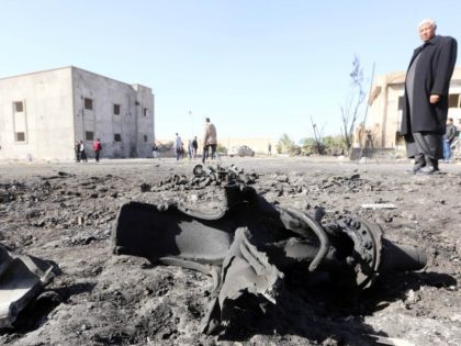 Libyans inspect the site of a suicide truck bombing on a police school in Libya's coastal city of Zliten, some 170 kilometres (100 miles) east of the capital Tripoli, which killed at least 50 people on January 7, 2016, in the deadliest attack to hit the strife-torn country since its …