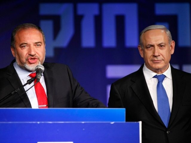 Israeli Prime Minister Benjamin Netanyahu and Former Israel Minister for Foreign Affairs Avigdor Liberman at his election campaign headquarters on Janurary 23, 2013 in Tel Aviv, Israel. Netanyahu was re-elected for a third term and will return to office, according to exit polls. Israel had the highest turnout of voters …
