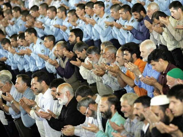Iranians pray after Iran's Guardian Council head Ahmad Jannati delivered his sermon during weekly Friday prayers at Tehran University in the Iranian capital, 09 June 2006.
