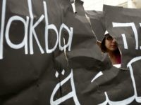 An Israeli Arab student is seen through a torn placard during a ceremony commemorating the 'Nakba Day' in front of Tel Aviv university on May 14, 2012 which was organised by Arab Israelis and left-wing students.