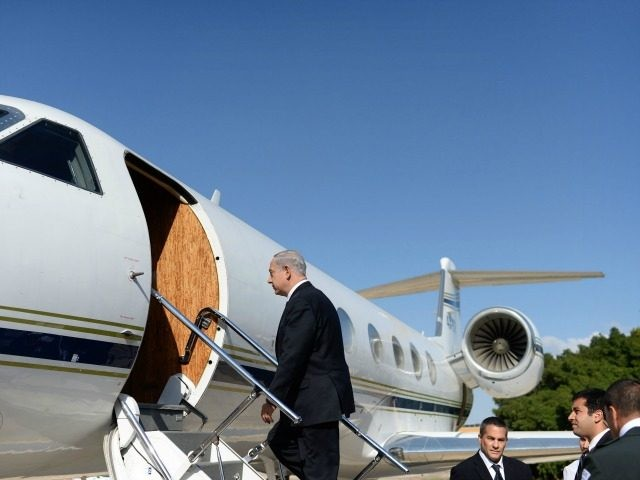 In this handout photograph supplied by the Government Press Office of Israel (GPO), Prime Minister Benjamin Netanyahu boards a plane at Ben Gurion airport on his way to Russia to hold talks on with Russian President Vladimir Putin on May 14, 2013 in Tel Aviv, Israel.