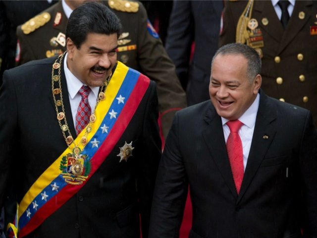 Venezuela's President Nicolas Maduro, left, shares a laugh with National Assembly President Diosdado Cabello upon his arrival to the National Assembly for a special session commemorating the country's Independence Day, in Caracas, Venezuela, Friday July 5, 2015. Venezuela is marking 204 years of independence. (AP Photos/Ariana Cubillos)