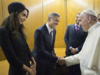 Pope Francis meets George Clooney and his wife Amal at the Vatican meeting (L'Osservatore Romano/Pool photo via AP)