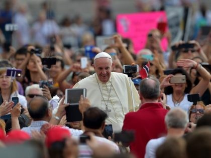 Pope Francis waves to faithful upon his arrival on St Peter's square at the Vatican to lead his weekly general audience on September 16, 2015.