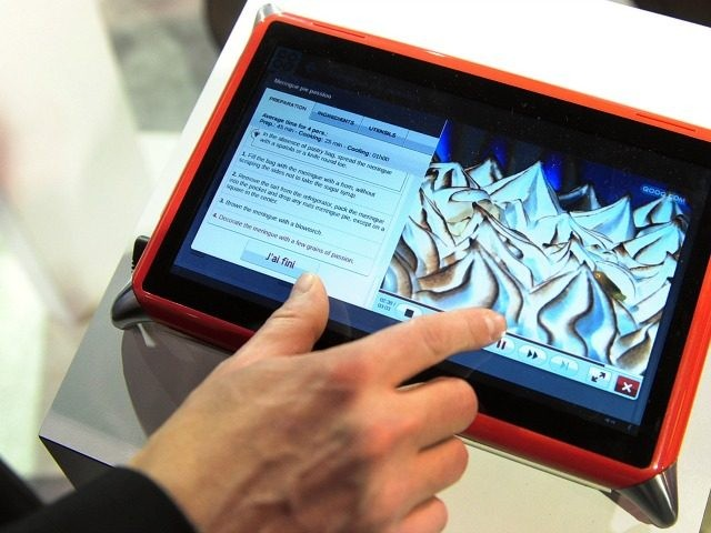 Guillame Hepp of Qooq-Unowhy gives a demonstration of the Qooq Cooking Tablet, a water-resistant sturdy device designed for use in the kitchen that runs off a Linux-based operating system with a kitchen-centric emphasis on recipes and food preparation, at the International Consumer Electronics Show (CES) in Las Vegas, Nevada, on …
