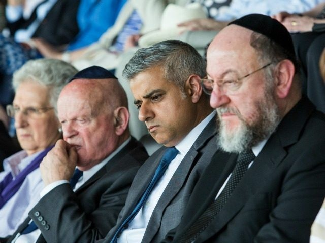 British Conservative Party politician Eric Pickles (L), Holocaust survivor Ben Helfgott MBE (3rd-L), London Mayor Sadiq Khan (C) and Chief Rabbi Ephraim Mirvis (R) attend Yom HaShoah, the Jewish Community's Holocaust Remembrance Day, at the Barnet Copthall Stadium on May 8, 2016 in London, England.