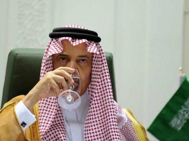 Saudi Foreign Minister Prince Saud bin al-Faisal drinks water during a joint press conference with his Algerian counterpart Ramtane Lamamra (unseen) following their meeting in Riyadh, on April 15, 2014.