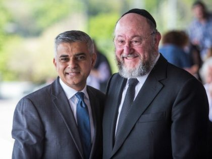 London Mayor Sadiq Khan (L) poses with Chief Rabbi Ephraim Mirvis (R) as they attend Yom HaShoah, the Jewish Community's Holocaust Remembrance Day, at the Barnet Copthall Stadium on May 8, 2016 in London, England.