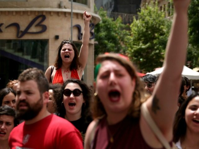 Israeli activists chant slogans during the 5th annual 'SlutWalk' march through central Jerusalem on May 13, 2016 to protest against rape culture, including sexual assault and harassment directed at women