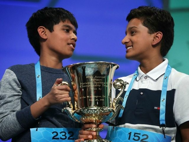 Spellers Nihar Saireddy Janga (L) of Austin, Texas and Jairam Jagadeesh Hathwar (R) of Painted Post, New York hold a trophy after the finals of the 2016 Scripps National Spelling Bee May 26, 2016 in National Harbor, Maryland. Both spellers were declared co-champions at the end of the annual spelling …