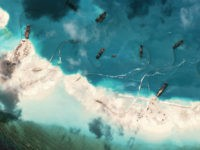 Dredgers deposit sand on the northern rim of the Mischief Reef, located 216 km (135 miles) west of the Philippine island of Palawan, in this Center for Strategic and International Studies (CSIS) Asia Maritime Transparency Initiative satellite image taken on February 1, 2015... REUTERS/CSIS'S ASIA MARITIME TRANSPARENCY INITIATIVE/DIGITAL GLOBE/HANDOUT