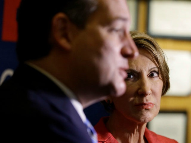 Vice-presidential candidate Carly Fiorina listens as Republican presidential candidate, Sen. Ted Cruz, R-Texas, speaks during a campaign stop at The Indiana War Memorial Friday, April 29, 2016, in Indianapolis. (AP Photo/Darron Cummings)