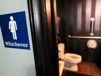 DURHAM, NC - MAY 11: A gender neutral sign is posted outside a bathrooms at Oval Park Grill on May 11, 2016 in Durham, North Carolina. (Photo by Sara D. Davis/Getty Images) *** Local Caption *** House Bill 2