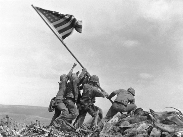 "FILE - In this Feb 23, 1945 file photo, U.S. Marines of the 28th Regiment, 5th Division, raise the American flag atop Mt. Suribachi, Iwo Jima, Japan. James Bradley, who wrote the book ""Flags of Our Fathers,"" said in a telephone interview Tuesday, May 3, 2016, that questions raised about the photo by two amateur historians, which have prompted a Marine Corps investigation, led him to think back on comments his father made about the 1945 flag-raising. Those comments by John Bradley, who died in 1994, now lead James Bradley to believe his father participated in an earlier flag-raising, but not the one captured in the famous picture. (AP Photo/Joe Rosenthal, File)"