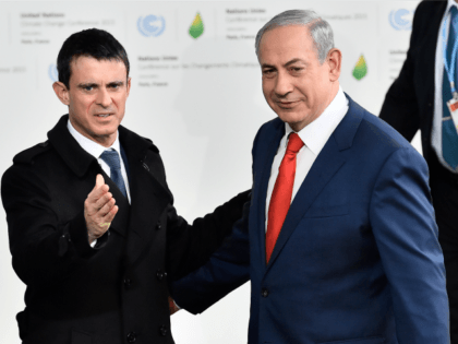 France's Prime Minister Manuel Valls (L) greets Israeli Prime Minister Benjamin Netanyahu as he arrives for the opening of the UN conference on climate change, on November 30, 2015 at Le Bourget, on the outskirts of the French capital Paris.