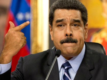 Venezuela's President Nicolas Maduro speaks during a press conference at the Miraflores presidential palace in Caracas, Venezuela, Tuesday, May 17, 2016. Maduro accused the United States of sabotage plans against Venezuela, saying they aim to create a scenario of violence to justify a foreign military intervention to remove him from …