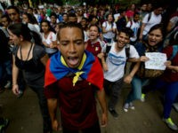 University students shout slogans against Venezuela's President Nicolas Maduro during a protest in Caracas, Venezuela, Thursday, May 26, 2016. The public university students marched to demand that the government provide more resources and avoid closing centers of study. (AP Photo/Fernando Llano)