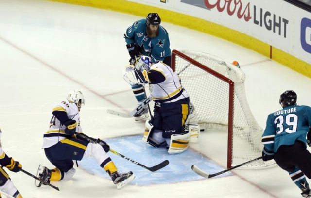 Joe Thornton (R) of the San Jose Sharks scores against the Nashville Predators in  Game Seven of the Western Conference Second Round