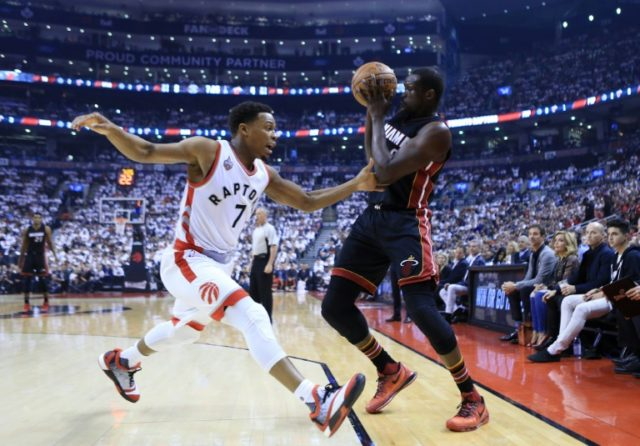 The Miami Heat defeated the Toronto Raptors 102-96 in overtime to claim a 1-0 lead