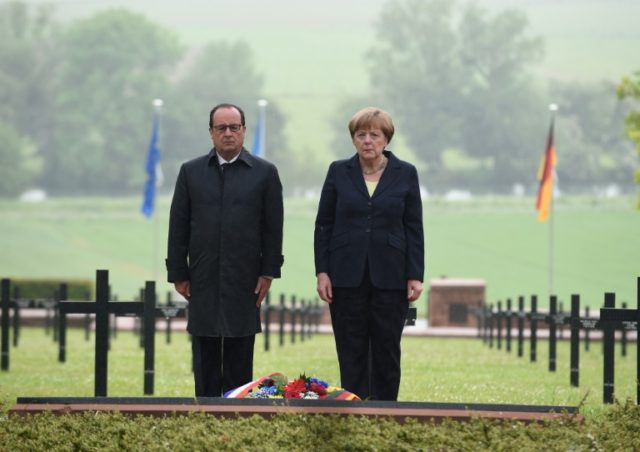 French President Francois Hollande and German Chancellor Angela Merkel on May 29, 2016, pay their respects at a remembrance ceremony marking the centenary of the battle of Verdun