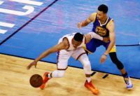 Russell Westbrook of the Oklahoma City Thunder drives against Stephen Curry of the Golden State Warriors in game four of the Western Conference Finals